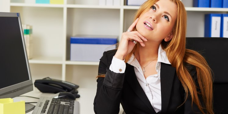 woman-in-office-pondering-something